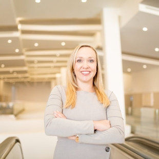 Woman at the top of an escalator