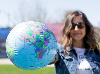 kait-with-globe