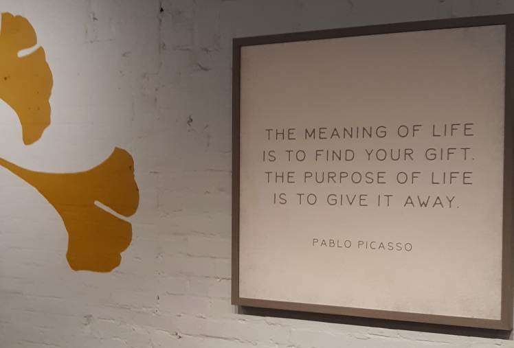 """Sign on the wall that reads """"The meaning of life is to find your gift. The purpose of life is to give it away."""""""
