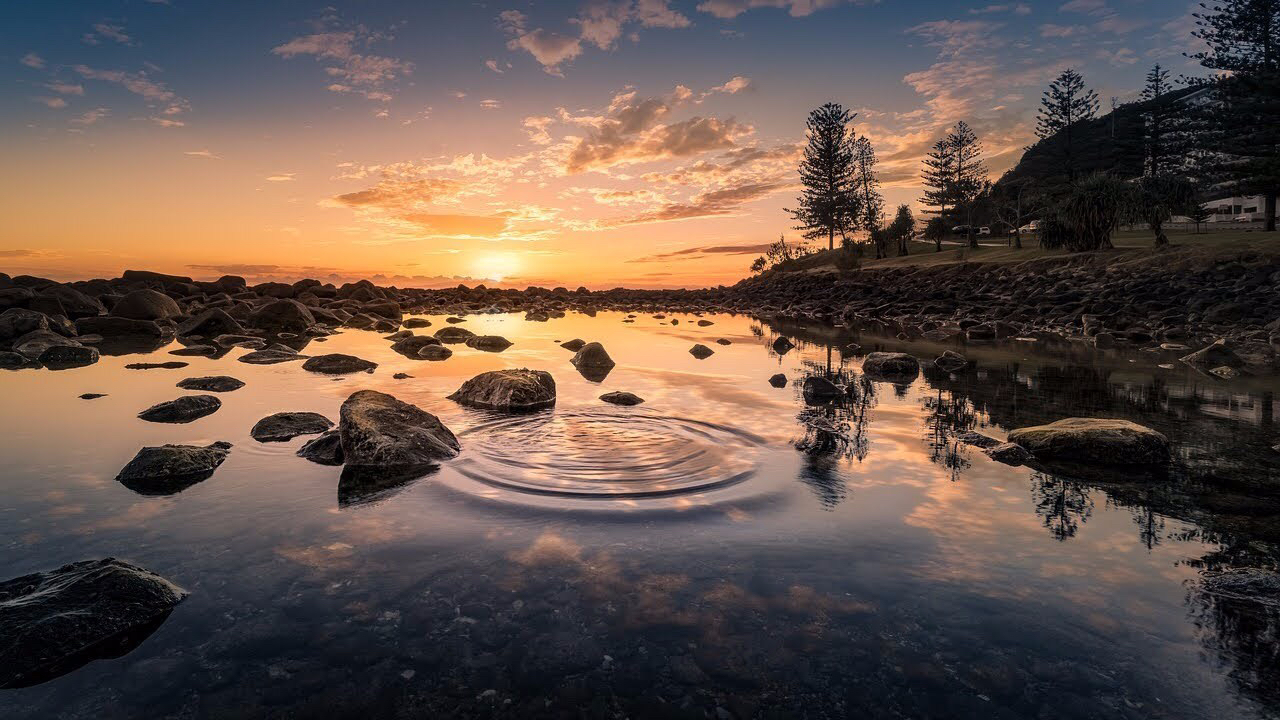 Water rippling on a pond at sunset.