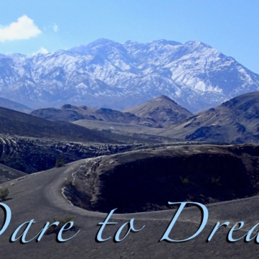 "Image of path leading to a mountain peak with ""Dare to Dream"" written across the bottom."