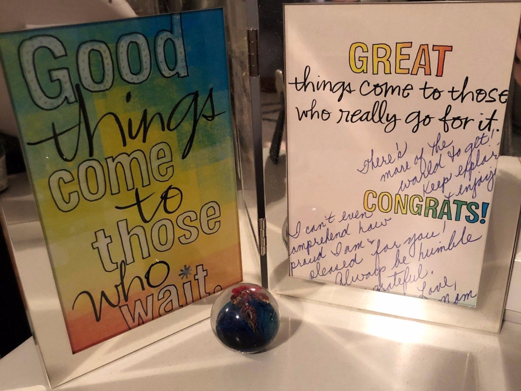 """Picture of a framed card that says, """"Good things come to those who wait. Great things come to those who really go for it."""" #gogettheworld #encouragement"""