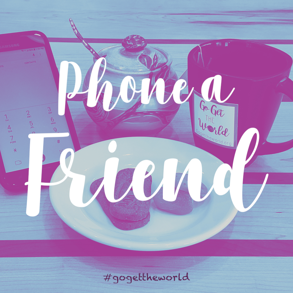 Having a cup of tea and cookies while phoning a friend.
