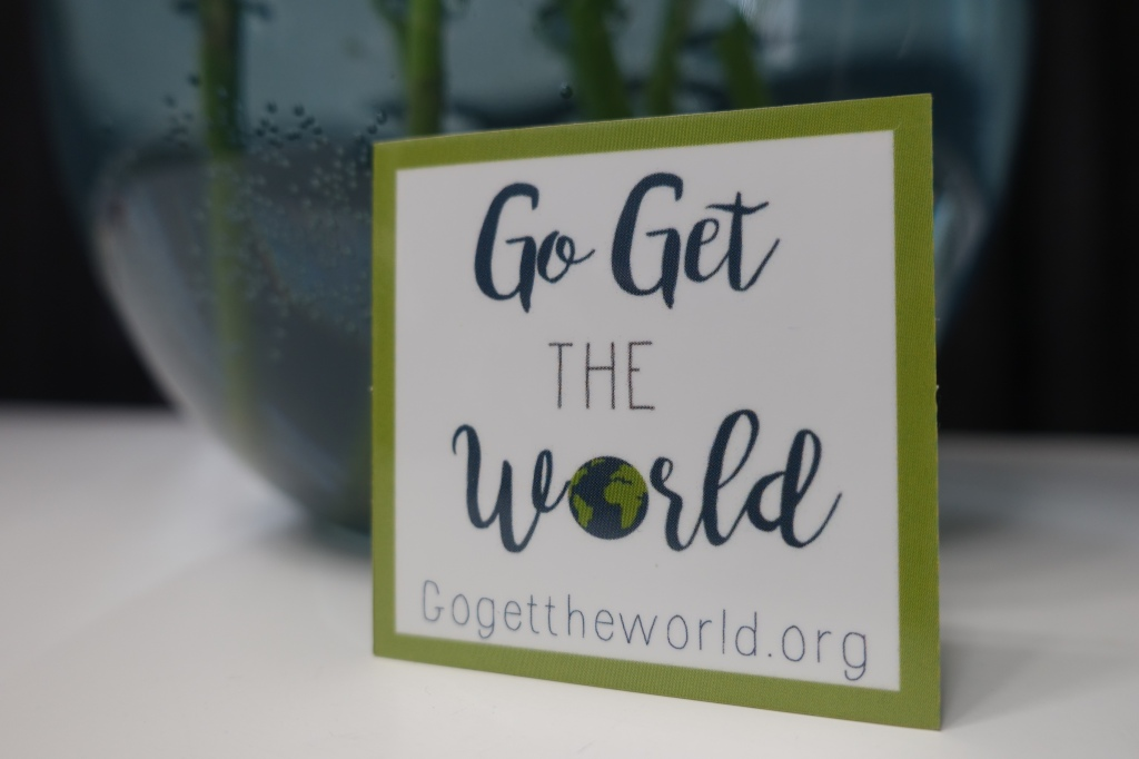 Photo of a Go Get The World sticker.