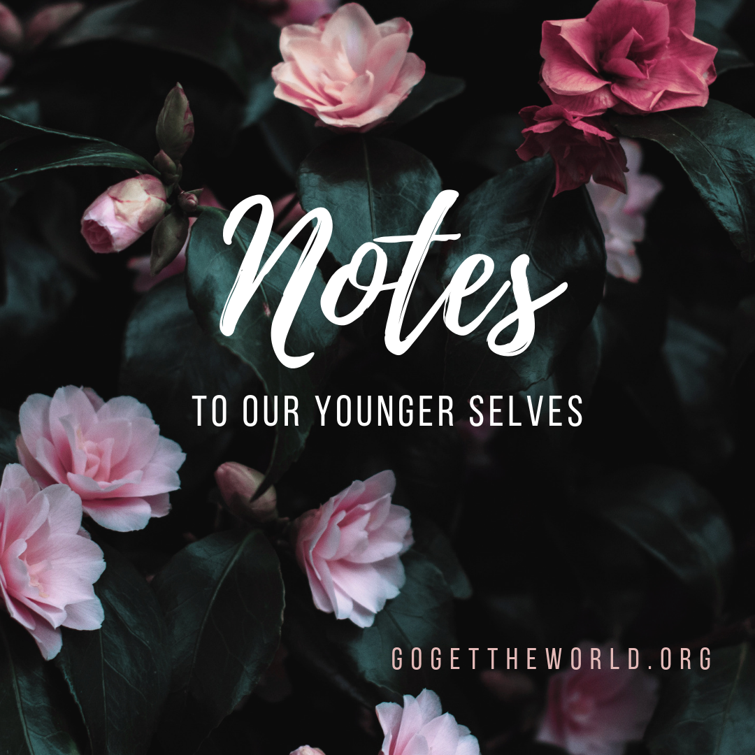 """Flower bed with """"Notes to our younger selves. Gogettheworld.org"""""""