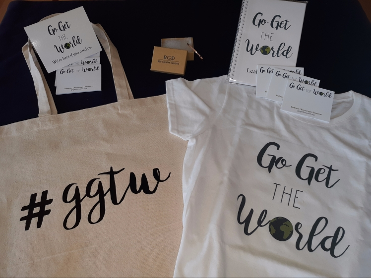 GGTW gifts for Leah include a canvas bag, t-shirt, post-it notes, a custom notebook and a bracelet.